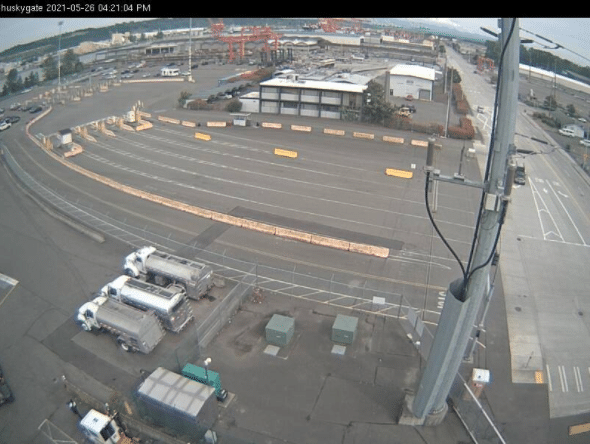 Road cam overlooking the port of Seattle Tacoma; checking truck and long hauler traffic.